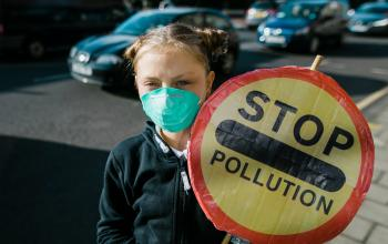 Edinburgh schoolchild wearing face mask to protect from air pollution